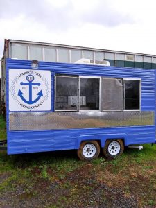 Harbor House Project blue trailer. Giving back to the community.